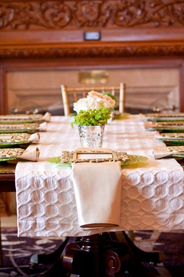 Table set-up with centerpiece and table runner