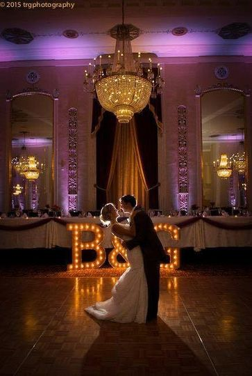 Couple under the chandelier first dance