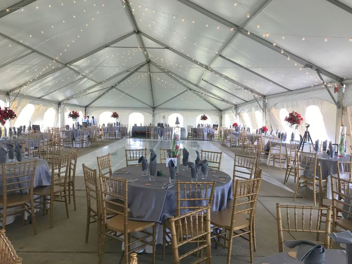 4000 square foot tent centered over the pool that we covered with a lighted dance floor