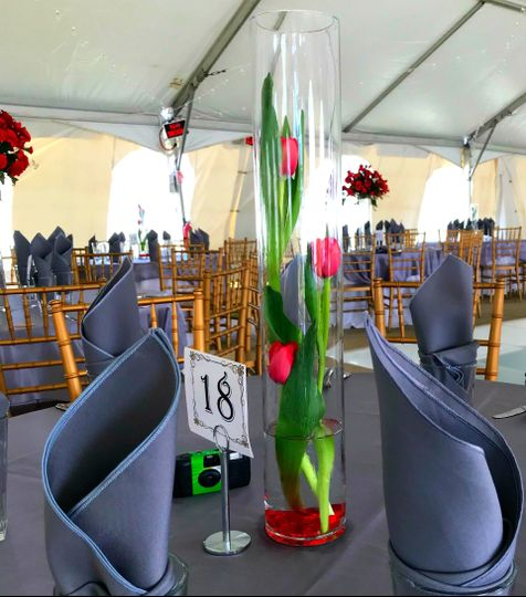 The use of different vases to show depth and variety of flowers.