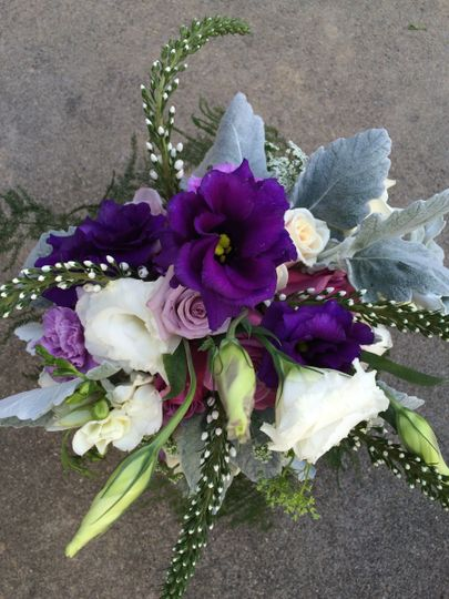 Bridesmaids bouquet with lisianthus, lysimachia, dusty miller and roses.
