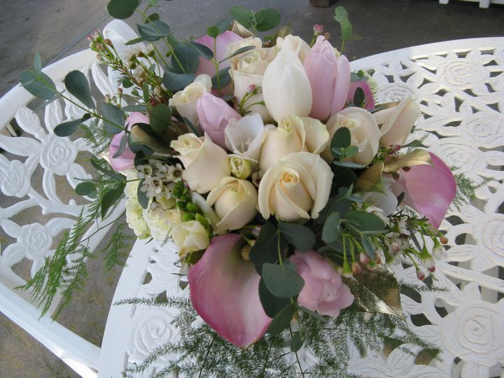 Bridal bouquet with roses, mini callas, eucalyptus and gold accents.