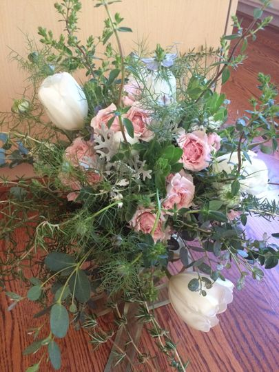 Romantic wildflower-look cascading bouquet with tulips, lamb's ear, rosemary, oregano,...