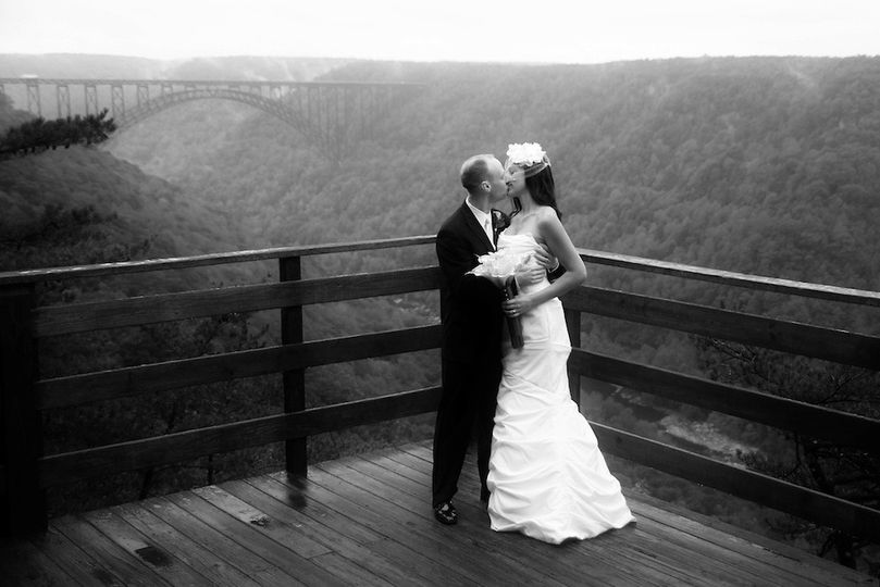 Couple kiss by the ledge