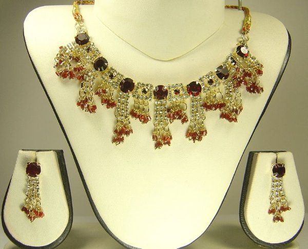 This stunning Royal Ruby and Crystal gold plated Necklace Set consists of 3 pieces.  ...