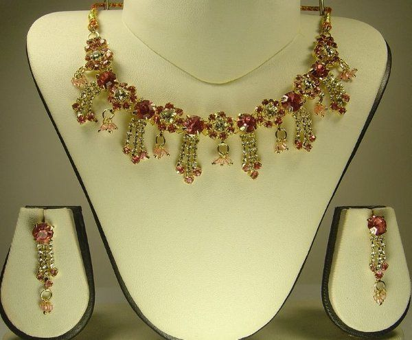 This stunning Royal Pink Sapphire English Garden Floral gold plated Necklace Set consists of 3...