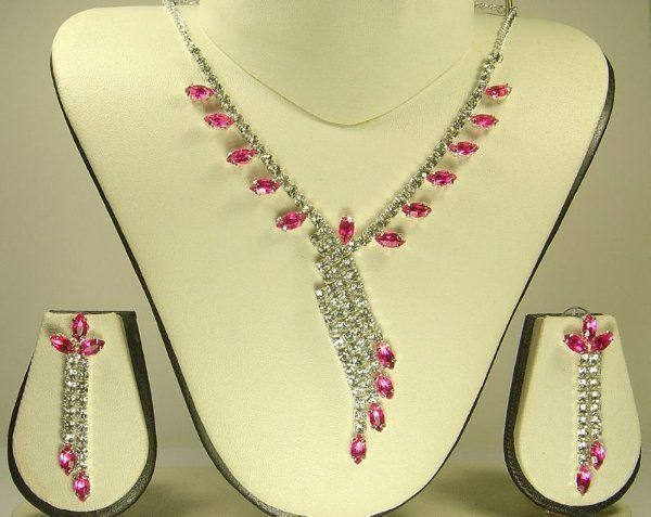 This is a Silver coated chain necklace with Sprakling White & Pink Australian Crystals in the shape...