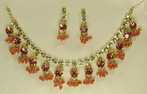 This is a Gold coated chain necklace with Sprakling White & Pink Australian Crystals in the shape of...