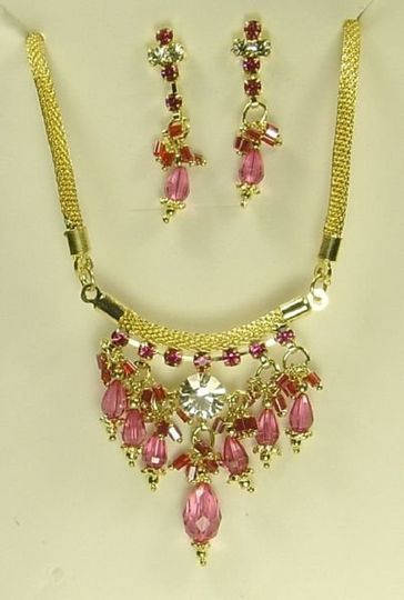 This is a Gold coated rope chain necklace with Sprakling White & Pink Australian Crystals in the...