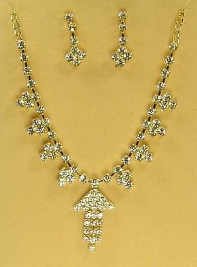 This is a Gold coated chain necklace with Sprakling White Australian Crystals, with up arrow pendant...