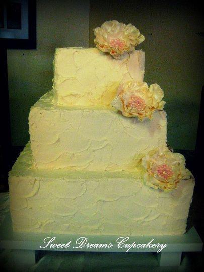 3 tier textured buttercream cake with gumpaste flowers