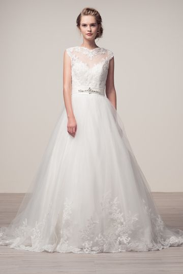 Illusion sweetheart neckline a-line ball gown wedding dress. Beautiful lace applique throughout...