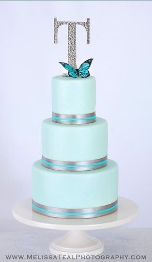Topper from http://www.couturecakejewelry.com/ 