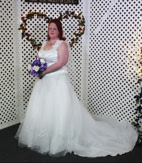 Bridal portrait in front of backdrop