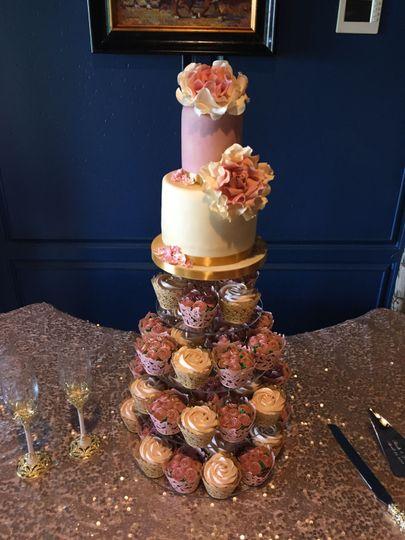 Small wedding cake and cupcake tower