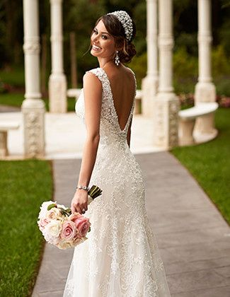 This Stella York wedding dress is made from vintage-inspired corded Lace on soft Tulle over Lavish...