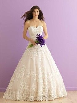 On this strapless ballgown, dreamy English net is covered with climbing floral lace applique and...