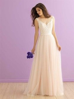 We adore the dreamy layers of tulle that make up this floating skirt. Lace bodice with satin band at...