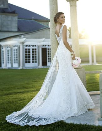 For traditional beauty, this lace bridal gown makes the cut. It features a romantic lace overlay,...