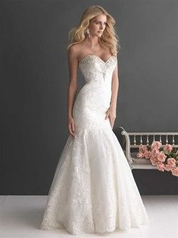 This gorgeous fit and flare shaped gown has a fitted bodice with a sweetheart neckline embellished...