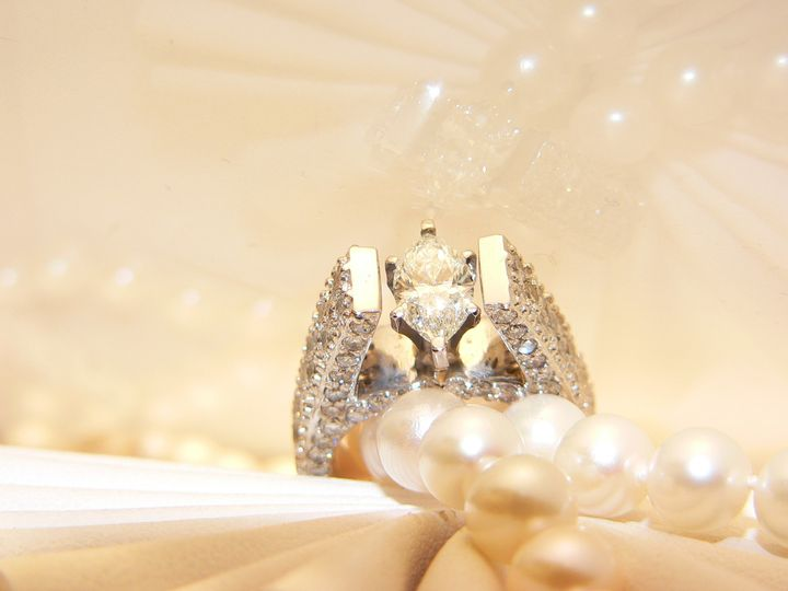 Custom made one of a kind diamond engagement ring on white gold. Bead set round diamonds on all...