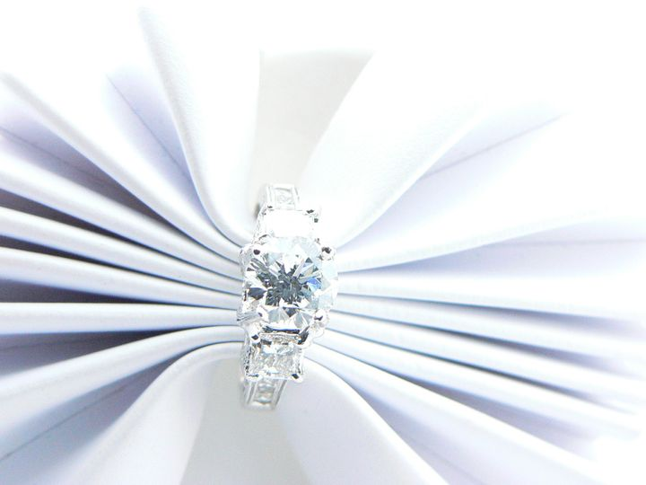 White gold diamond engagement ring with round diamond center stone.
