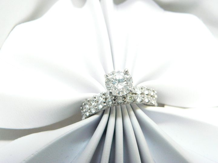 Stunning petite style diamond engagement ring when you want the Center stone to stand front and...