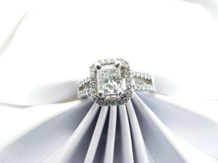 White gold Diamond engagement ring with emerald cut diamond center stone round diamond accent...