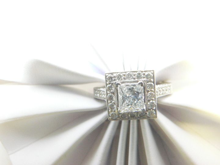 Halo princess diamond engagement ring.