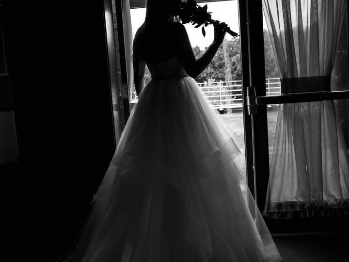 Bride looking out at Wild Wing