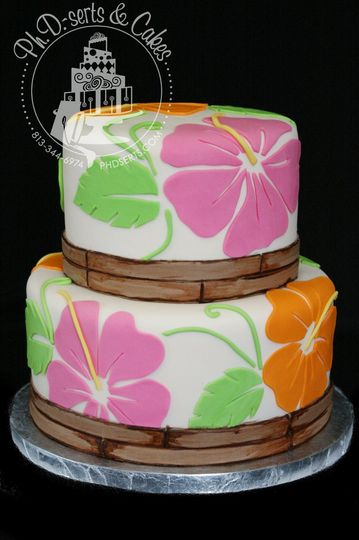 Perfect for a destination or beach-themed wedding with tropical flowers and an edible bamboo border.