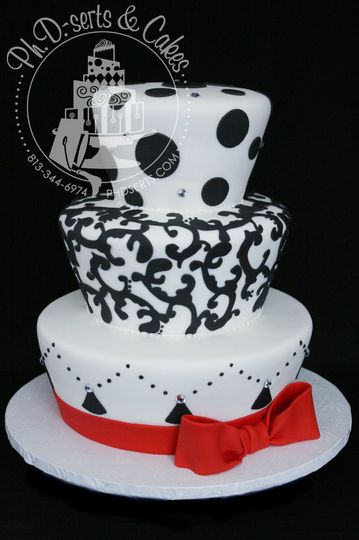 A twist on the traditional black and white wedding cake with carved sides to give the cake a...