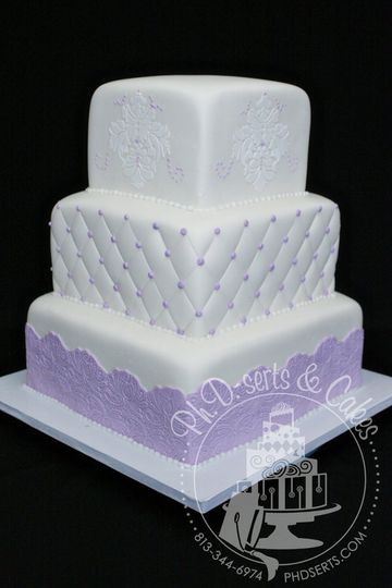 Cake covered in ivory fondant with lavender and white accents.  This cake would fit any wedding...