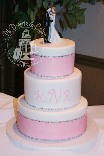 An all-buttercream cake with large pink ribbon and faux diamonds to add just the right amount of...