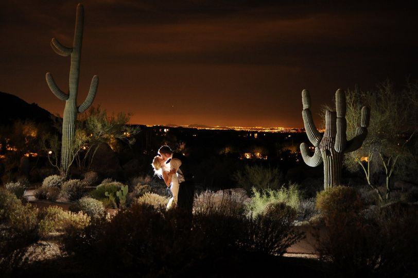 The newlywed kiss among the cacti