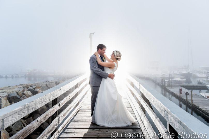 Couple embrace on a dock