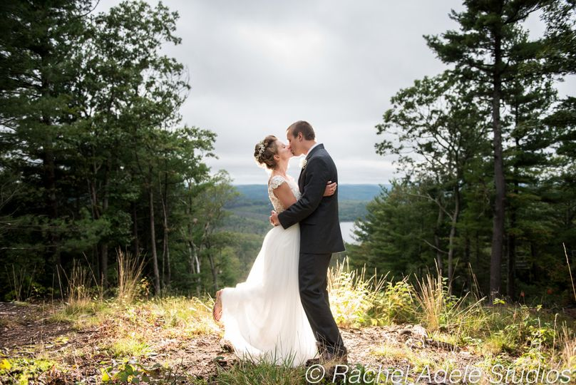 Couple kiss in front of scenic views
