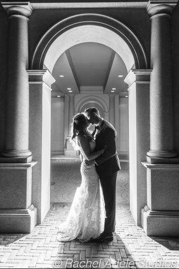 Couple kisses under arch