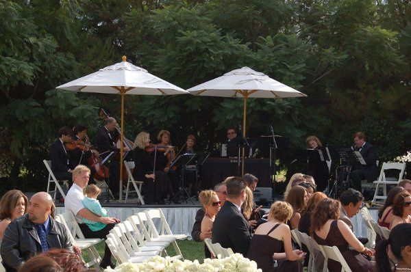 Our 9 piece chamber ensemble with male & female vocalists playing during a wedding prelude at the...
