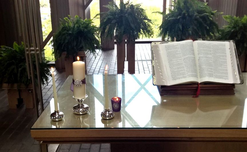 Unity candles and Bible.