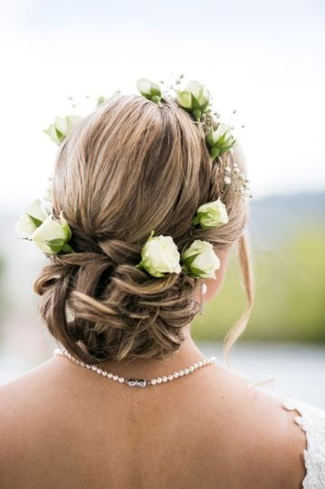 Low, semi-messy bun with spray roses