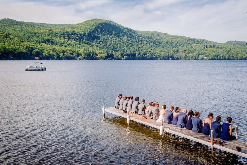 wedding party sitting on dock edit 51 45969 1567795960