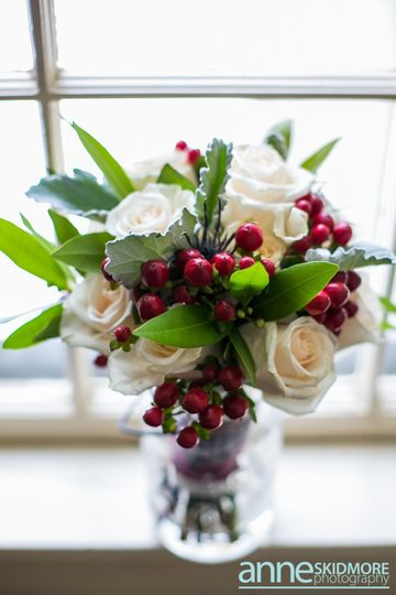 white rose and berry bouquet