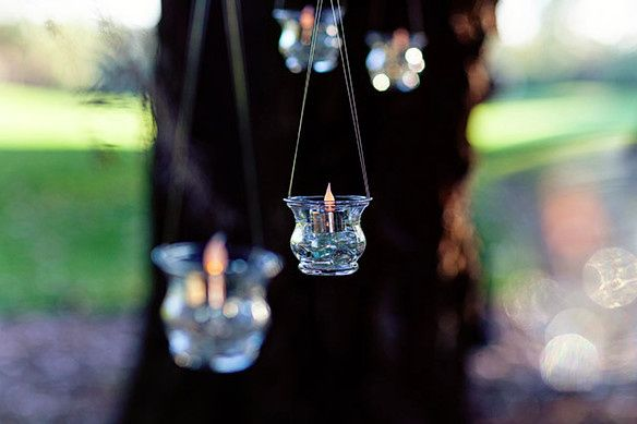 Hanging glass with candlelit