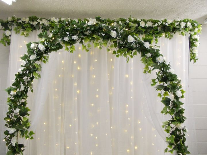 White flower backdrop and arch