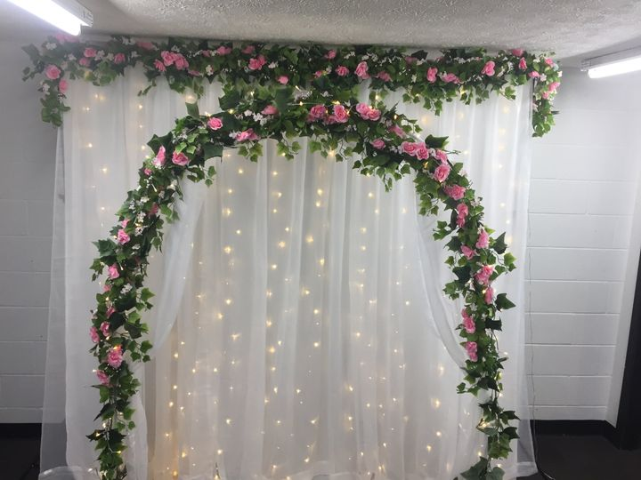 Pink flower backdrop and arch