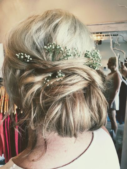 Baby's breath decorating the hair