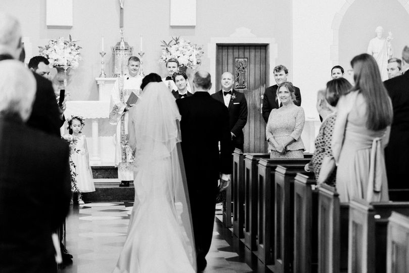 Bride down aisle to groom