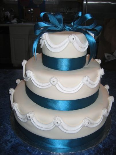 Vanilla cake with cream cheese frosting and Armena cherries, covered with a thin layer of fondant.