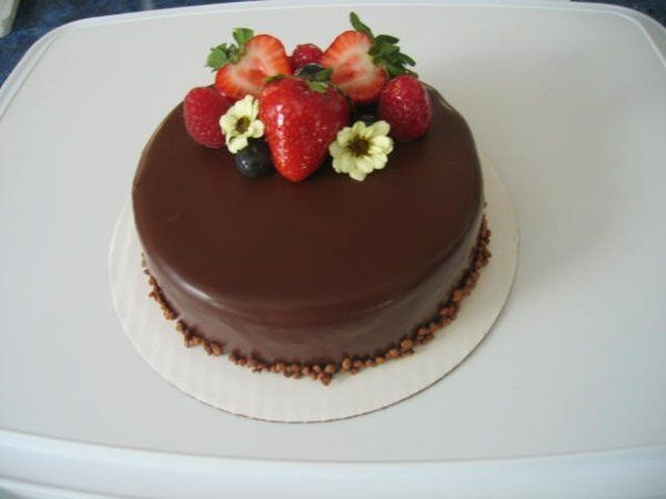 Chocolate mousse with mixed berries and chocolate cake.